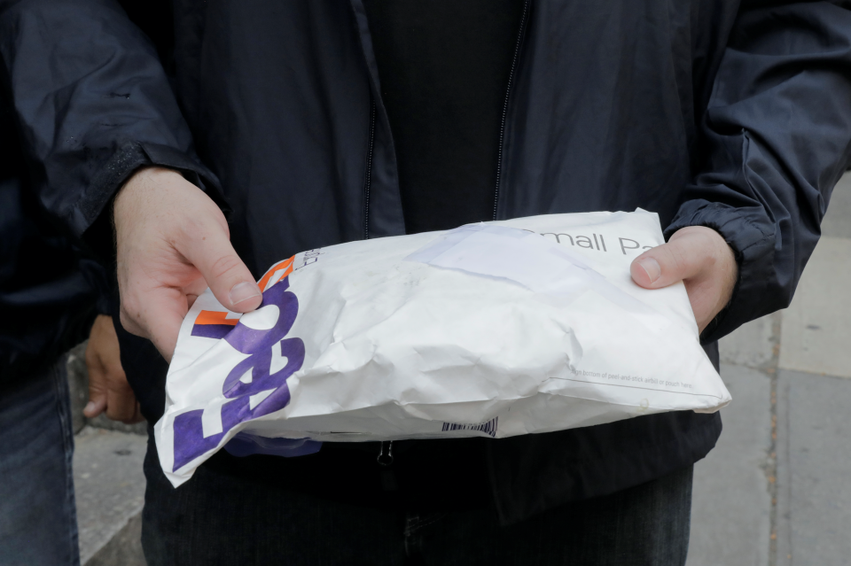 A package that had been intercepted containing fentanyl is held by a U.S. Immigration and Customs Enforcement's Homeland Security Investigations officer (HSI) in New York City., August 8, 2018. (Photo: REUTERS/Lucas Jackson)