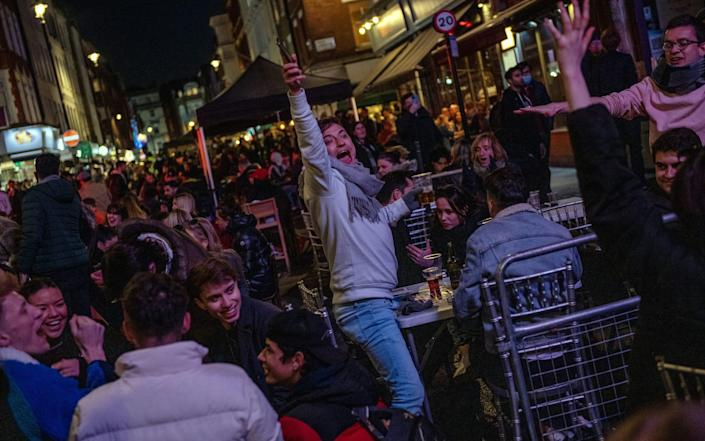 Rejoicing in Soho, London, where blockade restrictions were relaxed on April 12-Chris J. Ratcliff / Getty Images