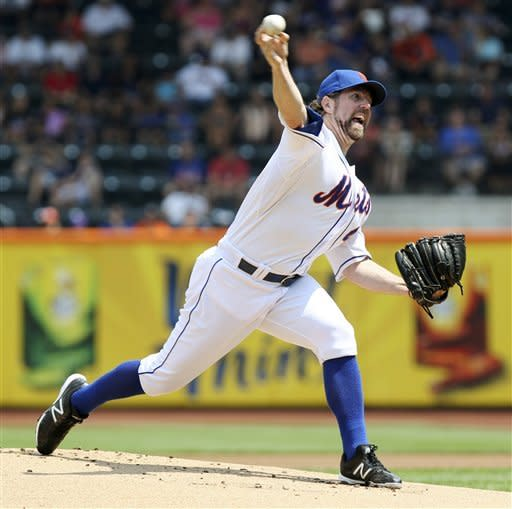 New York Mets' R.A. Dickey pitches during the first inning of a baseball game against the Miami Marlins, Thursday, Aug. 9, 2012, at Citi Field in New York. (AP Photo/Seth Wenig)