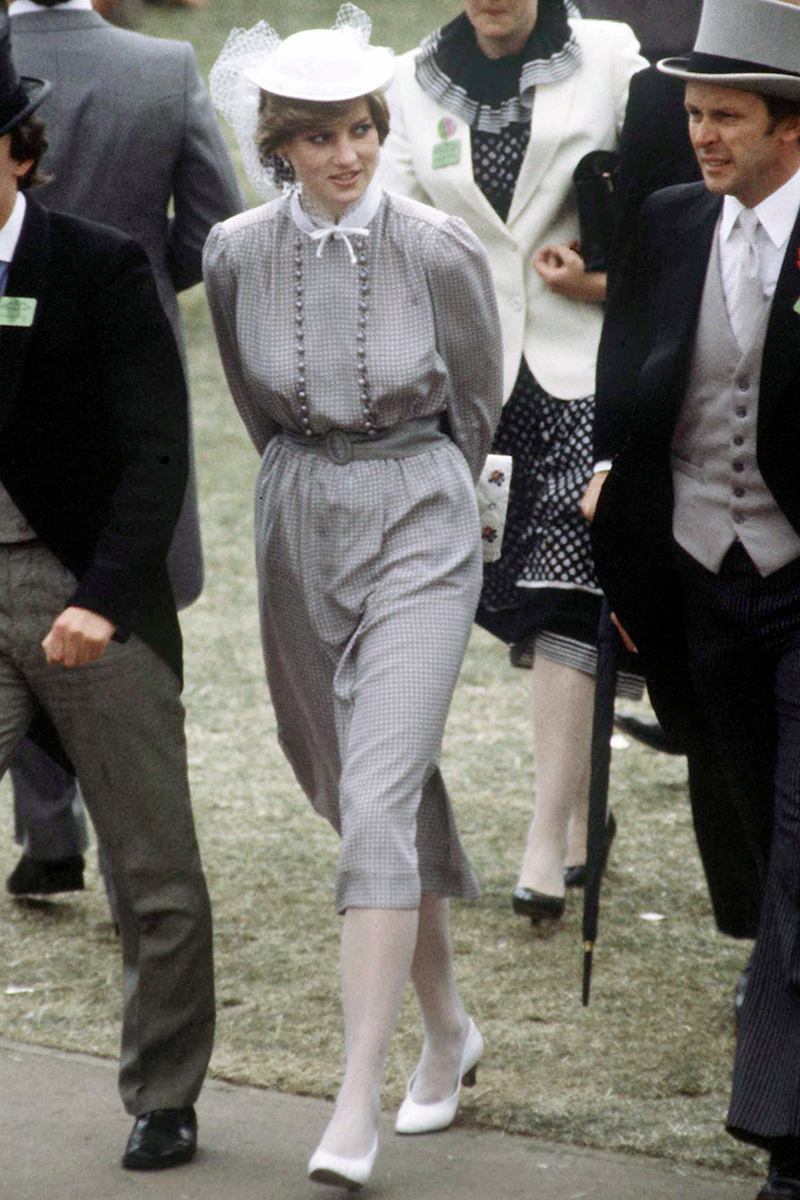 <p>This monochrome outfit, also worn to Royal Ascot, is peak '80s goodness, from the puffy sleeves and waist belt to the ivory court shoes and tulle fascinator, we're here for it.</p>