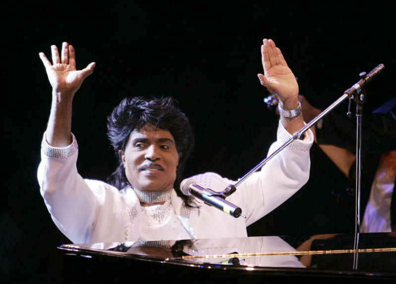 "FILE - In this Aug. 19, 2004 file photo, Little Richard performs at Westbury Music Fair in Westbury, NY.  Little Richard, the self-proclaimed ""architect of rock 'n' roll"" whose piercing wail, pounding piano and towering pompadour irrevocably altered popular music while introducing black R&B to white America, has died Saturday, May 9, 2020. (AP Photo/Ed Betz, File)"