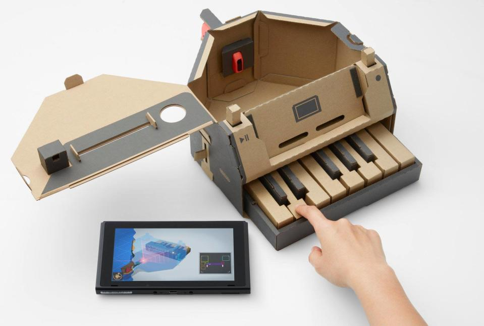 The Toy-Con Piano uses the Joy-Con's infrared camera to read small white stickers attached to each key to play notes.