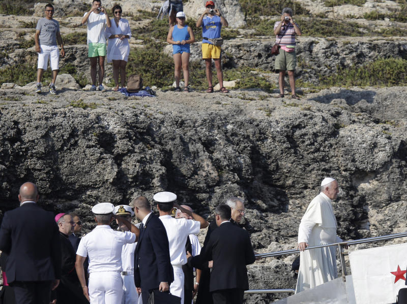 "Pope Francis, right, boards an Italian Coast Guard boat upon his arrival at the island of Lampedusa, southern Italy, Monday, July 8, 2013. Pope Francis heads Monday to the Sicilian island of Lampedusa for his first pastoral visit outside Rome, going to the farthest reaches of Italy to pray with migrants who have recently arrived and remember those who have died trying. Francis, a pope from ""the end of the Earth"" whose ancestors immigrated to Argentina from Italy, has a special place in his heart for refugees: As archbishop of Buenos Aires, he denounced the exploitation of migrants as ""slavery"" and said those who did nothing to stop it were complicit by their silence. On Monday, he will arrive at Lampedusa's port by boat and will throw a floral wreath into the sea in memory of those who died trying to reach the island, which is closer to Africa than the Italian mainland. (AP Photo/Gregorio Borgia)"