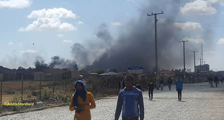 Plumes of smoke are seen behind buildings in Addis Ababa, Oromia,  Ethiopia February 13, 2018 in this still image obtained from social media video, Courtesy of TWITTER/@ADDISSTANDARD/via REUTERS