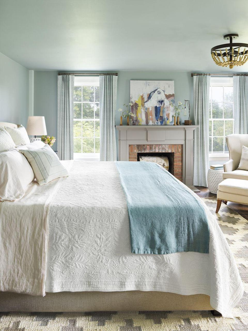 """<p>Give your bedroom the full spa treatment by painting it in a sea of soothing, watery blue. If you don't have crown molding, consider painting both the walls and the ceiling the same color to create a continuous look. Continue the continuity with simple curtains in a similar tone and then add a white or neutral rug, bedding, and upholstery to balance the color. Along with white, a warm gray such as <a href=""""https://go.redirectingat.com?id=74968X1596630&url=https%3A%2F%2Fwww.lowes.com%2Fpd%2FHGTV-HOME-by-Sherwin-Williams-Dovetail-Interior-Paint-Sample-Actual-Net-Contents-8-fl-oz%2F1000878534&sref=https%3A%2F%2Fwww.countryliving.com%2Fremodeling-renovation%2Fhome-makeovers%2Fg32468539%2Fbest-bedroom-paint-colors-ideas%2F"""" rel=""""nofollow noopener"""" target=""""_blank"""" data-ylk=""""slk:Dovetail from HGTV Home by Sherwin-Williams"""" class=""""link rapid-noclick-resp"""">Dovetail from HGTV Home by Sherwin-Williams</a>, makes a nice choice for trim and millwork.</p><p><strong>Get the Look:</strong><br>Wall and Ceiling Paint Color: <a href=""""https://go.redirectingat.com?id=74968X1596630&url=https%3A%2F%2Fwww.lowes.com%2Fpd%2FHGTV-HOME-by-Sherwin-Williams-Silvermist-Interior-Paint-Sample-Actual-Net-Contents-8-fl-oz%2F1001326394&sref=https%3A%2F%2Fwww.countryliving.com%2Fremodeling-renovation%2Fhome-makeovers%2Fg32468539%2Fbest-bedroom-paint-colors-ideas%2F"""" rel=""""nofollow noopener"""" target=""""_blank"""" data-ylk=""""slk:Silvermist from HGTV Home by Sherwin-Williams"""" class=""""link rapid-noclick-resp"""">Silvermist from HGTV Home by Sherwin-Williams</a><br></p>"""