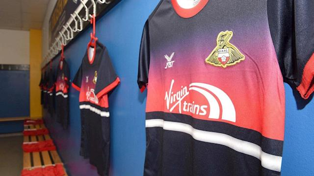 <p>Made by the Football Thai Factory Sporting Goods Company Ltd (who?), there is a lot going on with Donny's away kit. Far too much going on, in fact. (DRFC website) </p>