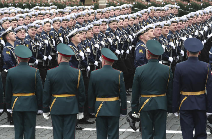 Russian sailors march toward Red Square during the Victory Day military parade in Moscow, Russia, Sunday, May 9, 2021, marking the 76th anniversary of the end of World War II in Europe. (AP Photo)