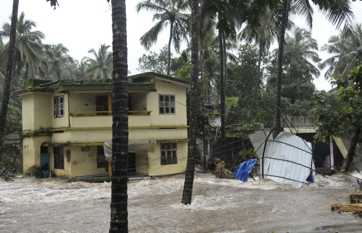 Roads and houses are engulfed in water following heavy rain and landslide in Kozhikode, Kerala state, India, Thursday, Aug. 9, 2018. Landslides triggered by heavy monsoon rains have killed more than a dozen people in southern India, cutting off road links and submerging several villages. (AP Photo)