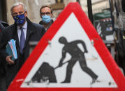 FILE - In this Wednesday, Nov. 11, 2020 file photo European Commission's Head of Task Force for Relations with the United Kingdom Michel Barnier walks from his hotel to the Conference Centre in London. Britain and the European Union have struck a provisional free-trade agreement that should avert New Year's chaos for cross-border commerce and bring a measure of certainty to businesses after years of Brexit turmoil. The breakthrough on Thursday, Dec. 24, 2020 came after months of tense and often testy negotiations that whittled differences down to three key issues: fair-competition rules, mechanisms for resolving future disputes and fishing rights. (AP Photo/Frank Augstein, File)