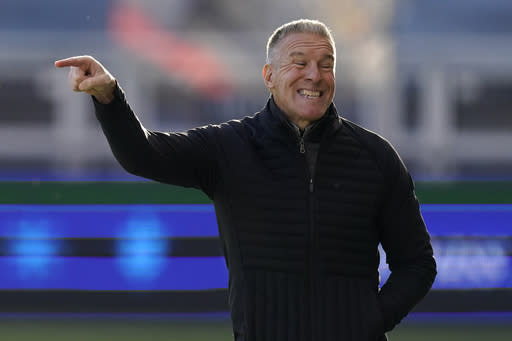 Sporting Kansas City manager Peter Vermes talks to his players during the first half of an MLS soccer match against the San Jose Earthquakes, Sunday, Nov. 22, 2020, in Kansas City, Kan. (AP Photo/Charlie Riedel)