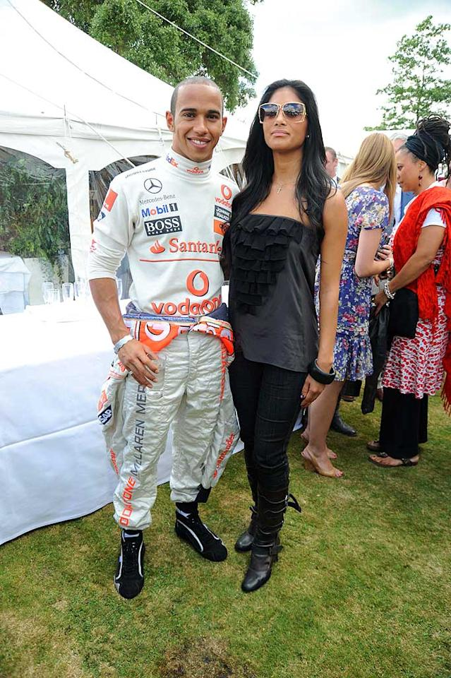 """Lewis Hamilton and Nicole Scherzinger may be all smiles standing side-by-side, but the Pussycat Doll has admitted she's """"terrified"""" when her Formula One beau takes her for a drive. <a href=""""http://www.gettyimages.com/"""" target=""""new"""">GettyImages.com</a> - July 13, 2008"""