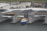 In this aerial photo, a damaged dock and ship are seen in the aftermath of Hurricane Ida, Monday, Sept. 6, 2021, in Port Fourchon, La. (AP Photo/Matt Slocum)