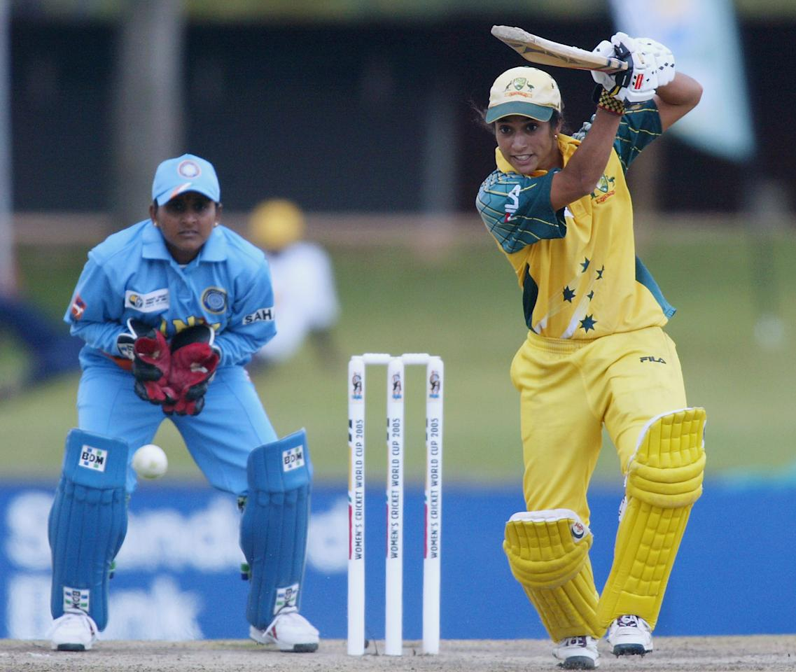 PRETORIA, SOUTH AFRICA - APRIL 10: (TOUCHLINE IMAGES ARE AVAILABLE TO CLIENTS IN THE UK, USA AND AUSTRALIA ONLY)  Lisa Sthalekar of Australia hits out watched by Anju Jain of India during the IWCC Women's World Cup Final match between India and Australia at Supersport Park Stadium on April 10, 2005 in Pretoria, South Africa. (Photo by Touchline/Getty Images)