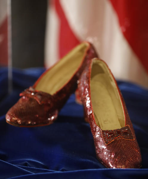 "A pair of ruby slippers once worn by actress Judy Garland in the ""The Wizard of Oz"" are displayed at a news conference Tuesday, Sept. 4, 2018, at the FBI office in Brooklyn Center, Minn. Authorities announced that the slippers, stolen in 2005 from the Judy Garland Museum in Grand Rapids, Minn., were recovered in a sting operation. The FBI says it has multiple suspects in the extortion and that the investigation continues. Four pairs of ruby slippers worn by Garland in the movie are known to exist. (Richard Tsong-Taatarii/Star Tribune via AP)"
