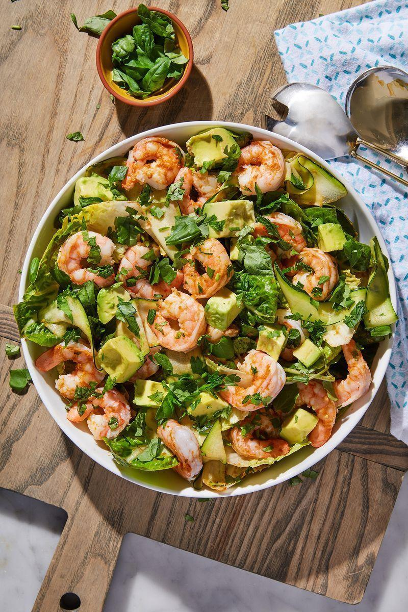 """<p>This <a href=""""https://www.delish.com/uk/cooking/recipes/a31658178/taco-lime-shrimp-recipe/"""" rel=""""nofollow noopener"""" target=""""_blank"""" data-ylk=""""slk:prawn"""" class=""""link rapid-noclick-resp"""">prawn</a> salad is one of our favourite things to throw together. It takes literally 10 minutes to put together but thanks to the zingy dressing and fresh ingredients, it feels like so much love and attention has gone into it. </p><p>Get the <a href=""""https://www.delish.com/uk/cooking/recipes/a31952820/prawn-salad/"""" rel=""""nofollow noopener"""" target=""""_blank"""" data-ylk=""""slk:Prawn, Avocado & Courgette Salad"""" class=""""link rapid-noclick-resp"""">Prawn, Avocado & Courgette Salad</a> recipe.</p>"""