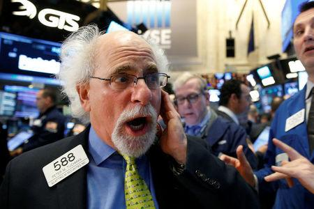 Trader Peter Tuchman works on the floor of the New York Stock Exchange (NYSE) in the Manhattan borough of New York, New York, U.S., April 4, 2017. REUTERS/Brendan McDermid