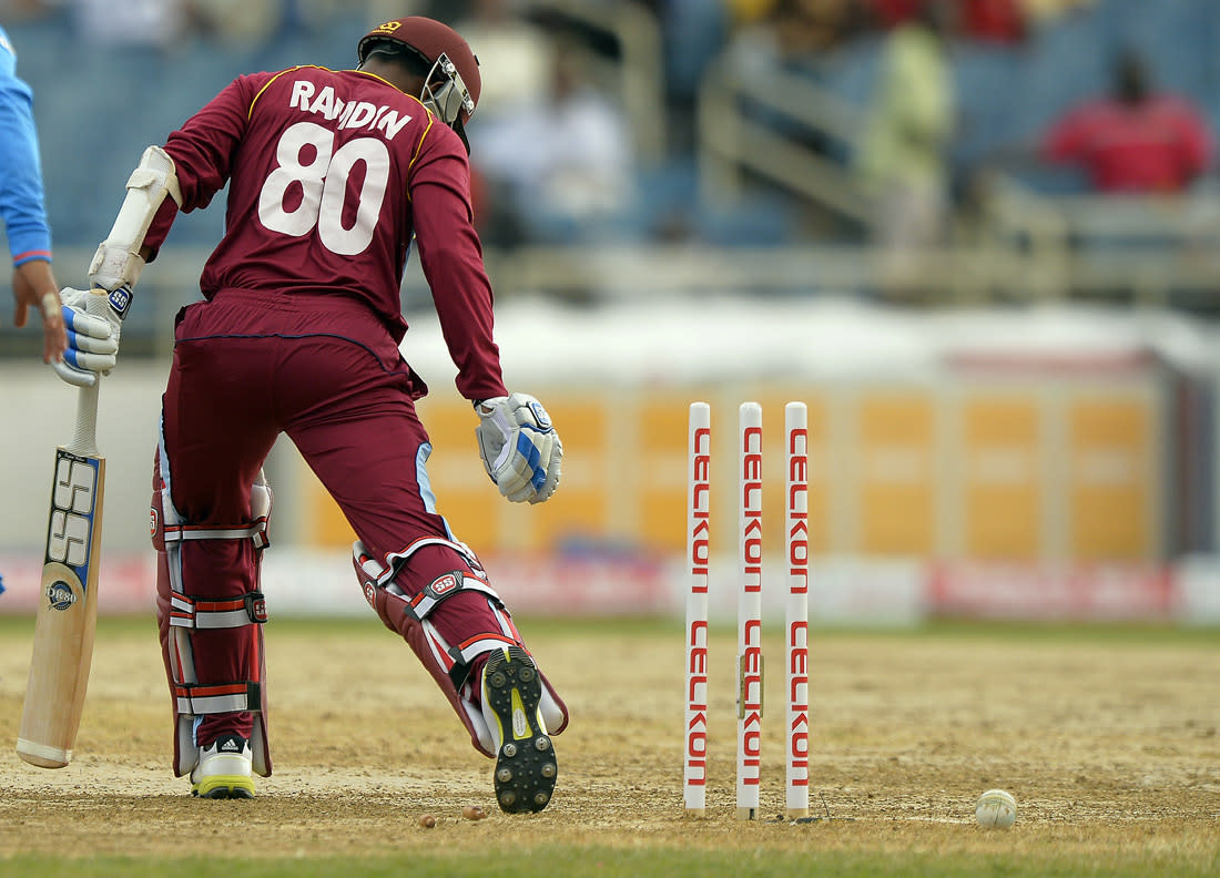 West Indies batsman Denesh Ramdin is clean bowled off Indian bowler Ravichandran Ashwin during the second match of the Tri-Nation series between Indian and West Indies at the Sabina Park stadium in Kingston on June 30, 2013. India have scored 229/7 at the end of their innings. AFP PHOTO/Jewel Samad        (Photo credit should read JEWEL SAMAD/AFP/Getty Images)