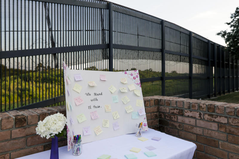A table with notes and markers allowed community members to share their messages and prayers for the victims of the recent shooting in El Paso during a vigil Sunday, Aug. 11, 2019, at Alice Wilson Hope Park in Brownsville, Texas.(Denise Cathey/The Brownsville Herald via AP)