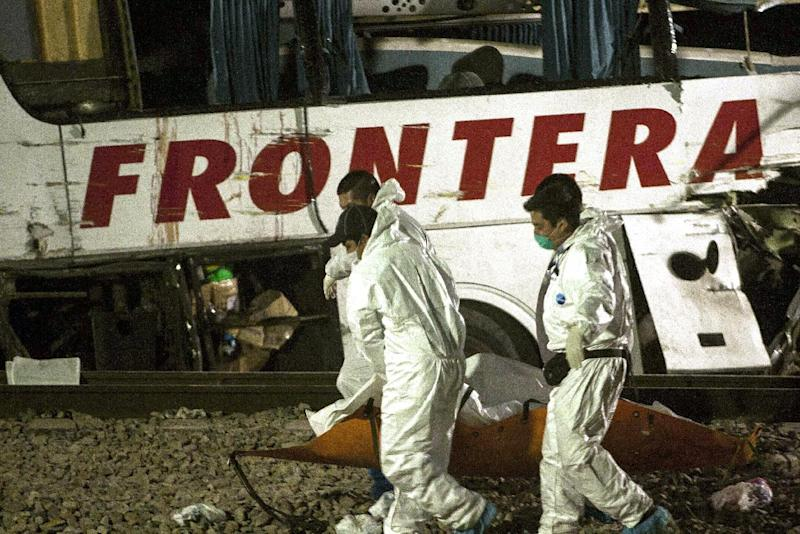 Images broadcast by local media showed the bus smashed open and split in half by the force of the train (AFP Photo/Julio Cesar Aguilar)