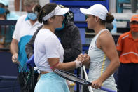 Bianca Andreescu of Canada, left, and Ashleigh Barty of Australia, meet at the net after the finals at the Miami Open tennis tournament, Saturday, April 3, 2021, in Miami Gardens, Fla. Barty won 6-3, 4-0, as Andreescu retired due to injury. (AP Photo/Lynne Sladky)