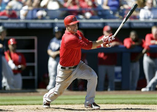 Los Angeles Angels' Mike Trout hits a double against the San Diego Padres during the third inning in an exhibition spring training baseball game Wednesday, March 13, 2013, in Peoria, Ariz. (AP Photo/Gregory Bull)