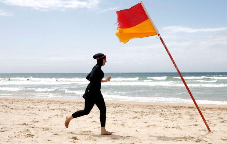 A woman on a beach in her burkini. (Photo: TIM WIMBORNE / Reuters)