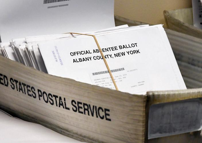 A box of absentee ballots wait to be counted at the Albany County Board of Elections in Albany, N.Y. on June 30, 2020.