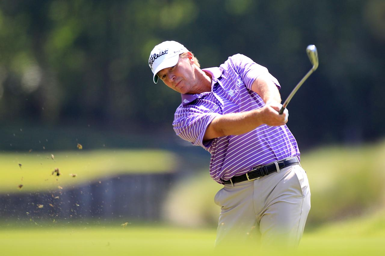 PONTE VEDRA BEACH, FL - MAY 10:  Steve Stricker of the United States hits an approach shot on the seventh hole during the first round of THE PLAYERS Championship held at THE PLAYERS Stadium course at TPC Sawgrass on May 10, 2012 in Ponte Vedra Beach, Florida.  (Photo by Sam Greenwood/Getty Images)