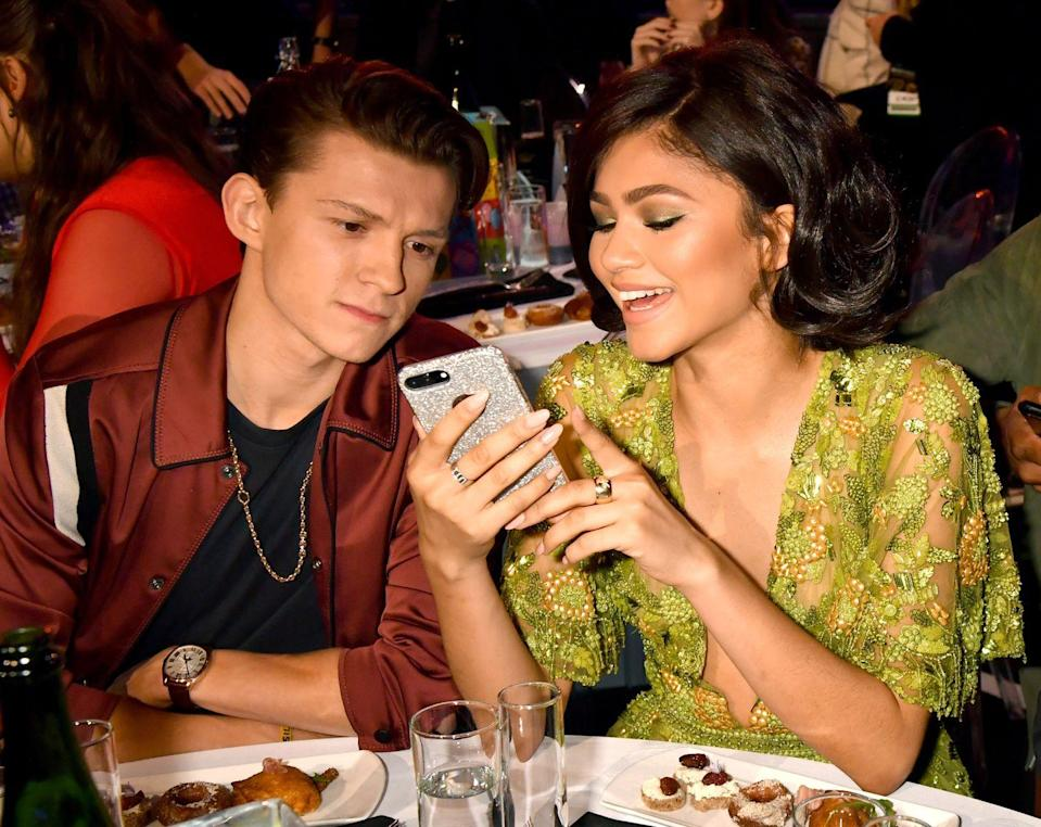 <p>Tom Holland (L) and Zendaya attend the 2017 MTV Movie And TV Awards at The Shrine Auditorium on May 7, 2017 in Los Angeles, California.</p>