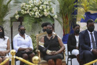 First Lady Martine Moise, center, sits during a tribute for her late husband President Jovenel Moise at the National Pantheon Museum in Port-au-Prince Haiti, Wednesday, July 21, 2021. President Moise was assassinated on July 7 during an attack at their home that left her injured. ( AP Photo/Joseph Odelyn)