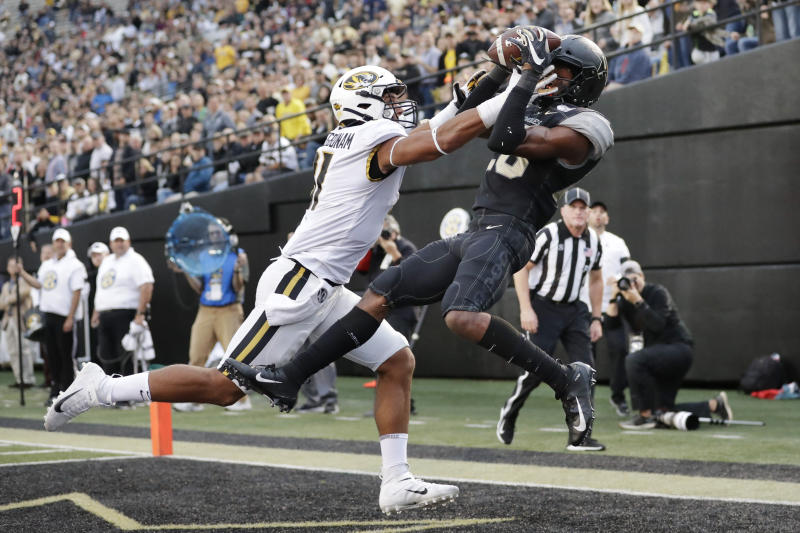 Vanderbilt defensive back Allan George, right, intercepts a pass intended for Missouri tight end Albert Okwuegbunam, left, in the end zone during the second half of an NCAA college football game Saturday, Oct. 19, 2019, in Nashville, Tenn. Vanderbilt upset Missouri 21-14. (AP Photo/Mark Humphrey)