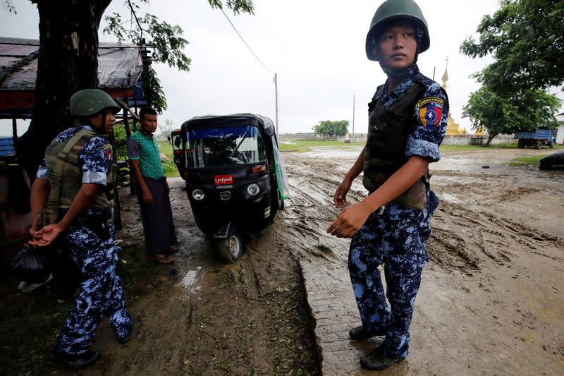 FILE PHOTO: Myanmar police officer stands guard in Maungdaw, Rakhine