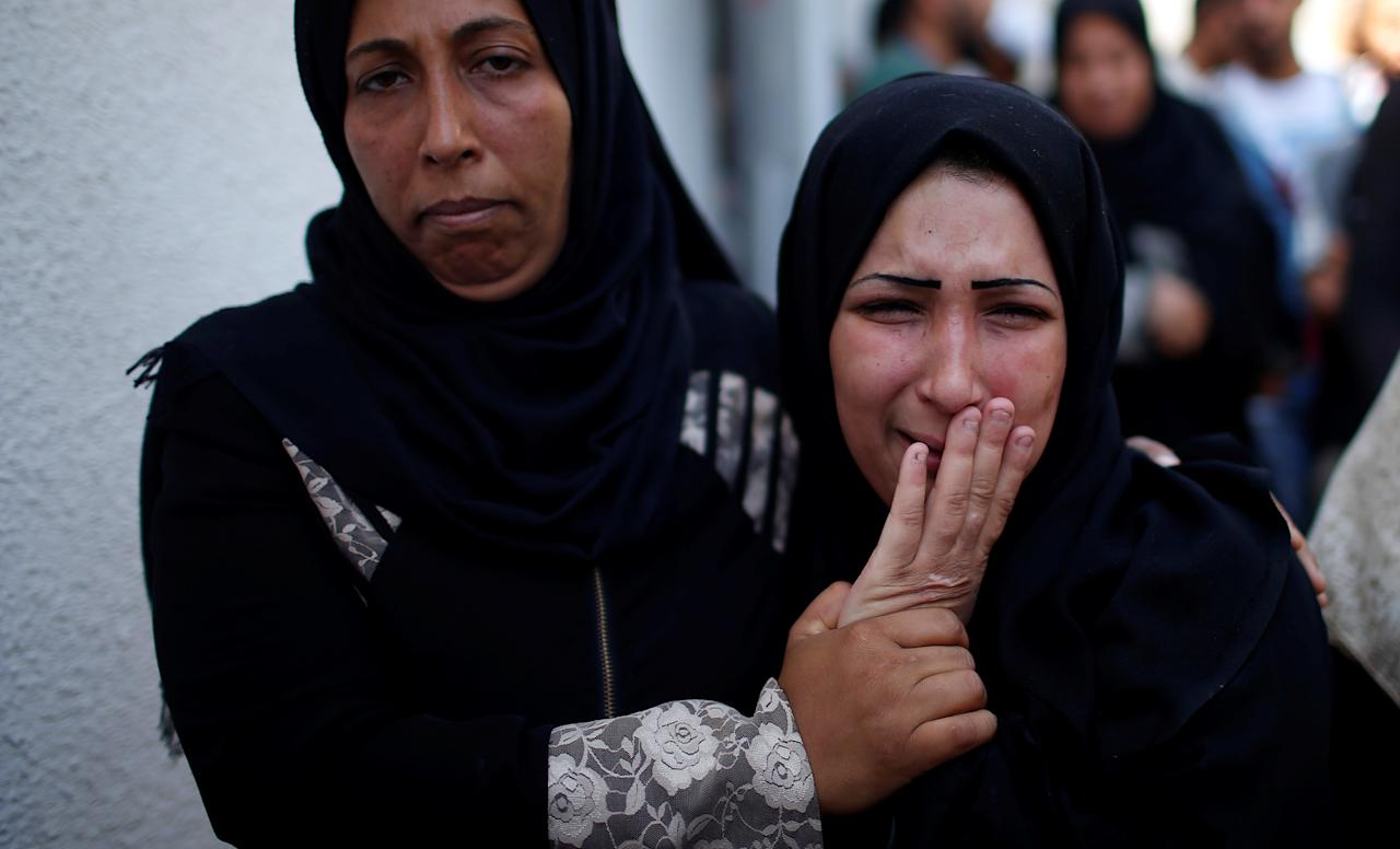 <p>The mother of 8-month-old Palestinian infant Laila al-Ghandour, who died after inhaling tear gas during a protest against U.S. embassy move to Jerusalem at the Israel-Gaza border, mourns during her funeral in Gaza City, May 15, 2018. (Photo: Mohammed Salem/Reuters) </p>