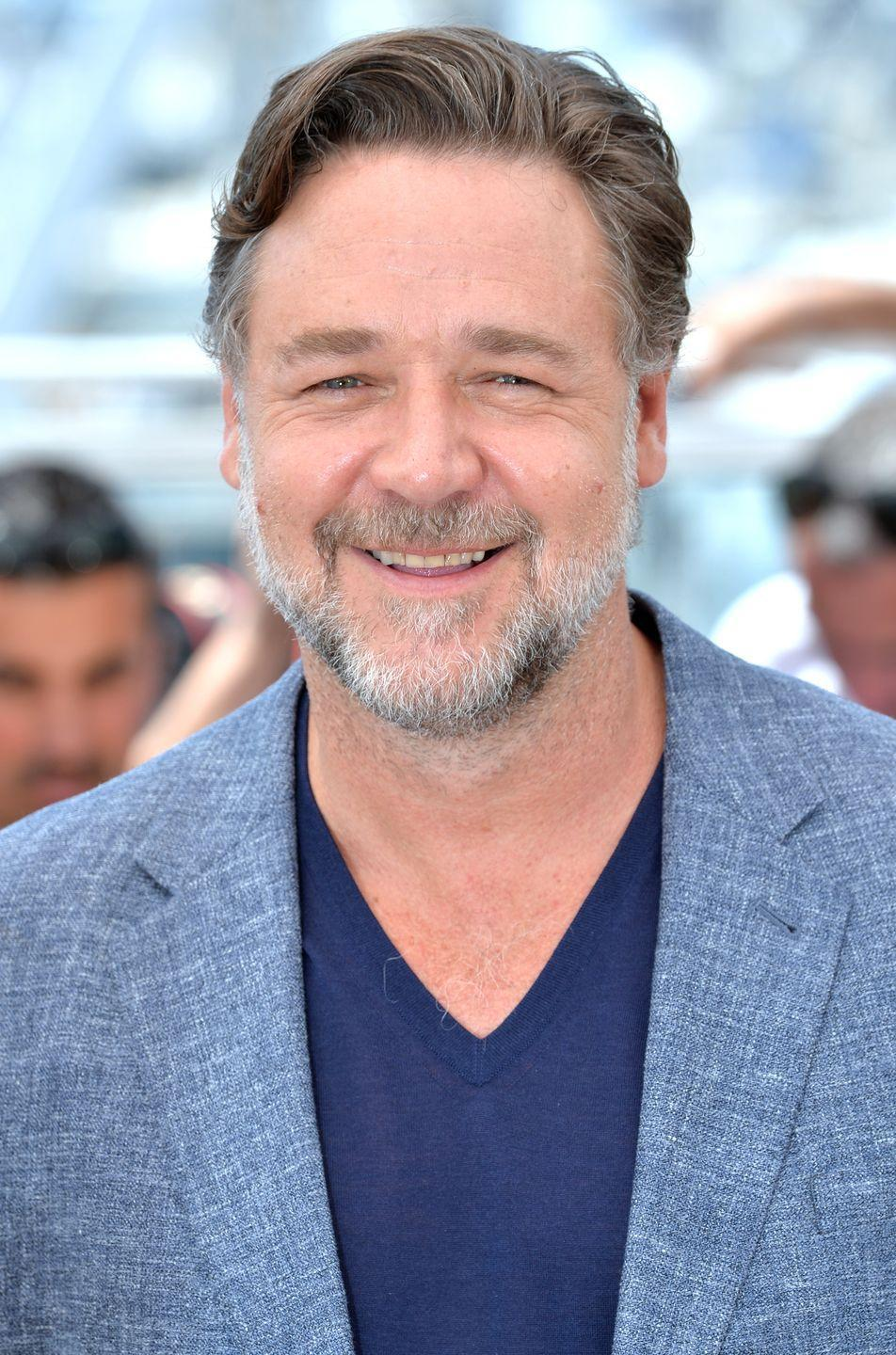 <p>They may be wispy, but they're there! Russell Crowe proves that you don't need to have a lot of chest hair to pull off a low V-neck.</p>