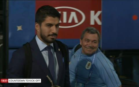 Luis Suarez gets off the coach - Credit: BBC