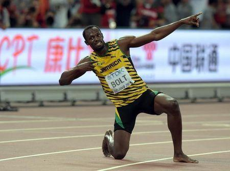 Usain Bolt (JAM) poses after winning the 200m in 19.55 during the IAAF World Championships in Athletics at National Stadium. Kirby Lee-USA TODAY Sports