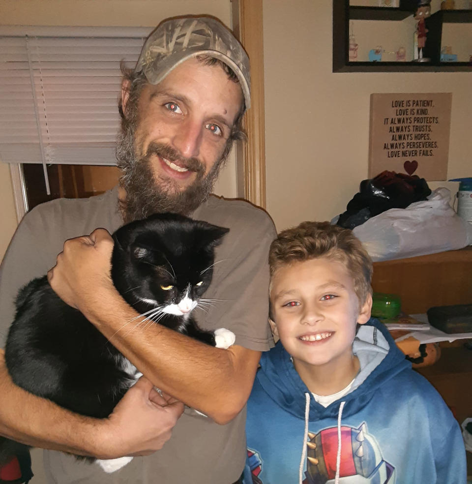 Clevenger's husband and one of their children pose with Panda. (Courtesy Christina Clevenger)