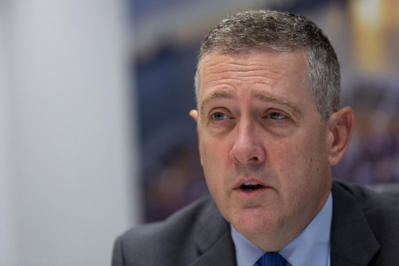 """President and CEO of the Federal Reserve Bank of St. Louis James Bullard speaks during an interview with AFP in Washington, DC, on August 6, 2019. - The Federal Reserve has set US interest rates """"in the right neighborhood,"""" but will watch how the economy reacts to factors like the trade war, James Bullard, a key member of the central bank policy board, told AFP on Tuesday. However, Bullard, president of St Louis Federal Reserve Bank, said the Fed """"can't realistically move monetary policy in a tit-for-tat trade war."""" Still, policymakers have """"already done quite a bit"""" to help the economy and account for the uncertainty surrounding President Donald Trump's trade wars. (Photo by Alastair Pike / AFP) (Photo credit should read ALASTAIR PIKE/AFP via Getty Images)"""