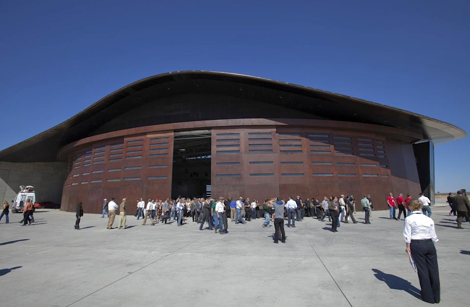 Guests stand outside the new Spaceport America hangar in New Mexico, US.