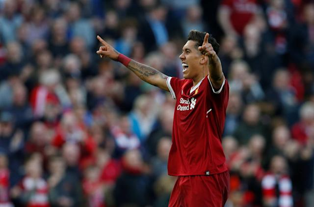 "Soccer Football - Premier League - Liverpool vs AFC Bournemouth - Anfield, Liverpool, Britain - April 14, 2018 Liverpool's Roberto Firmino celebrates scoring their third goal REUTERS/Andrew Yates EDITORIAL USE ONLY. No use with unauthorized audio, video, data, fixture lists, club/league logos or ""live"" services. Online in-match use limited to 75 images, no video emulation. No use in betting, games or single club/league/player publications. Please contact your account representative for further details."