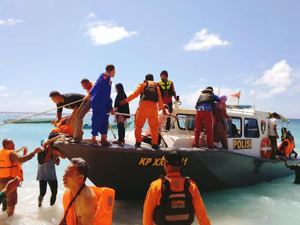 Passengers are brought to safety after being forced overboard (NSRA)
