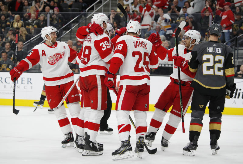 Detroit Red Wings celebrate after right wing Anthony Mantha scored against the Vegas Golden Knights during the third period of an NHL hockey game Saturday, March 23, 2019, in Las Vegas. (AP Photo/John Locher)
