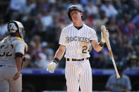 Colorado Rockies' Ryan McMahon, right, reacts after striking out against Pittsburgh Pirates relief pitcher Keone Kela as Pittsburgh Pirates catcher Elias Diaz, left, heads to the dugout to end the eighth inning of a baseball game Sunday, Sept. 1, 2019, in Denver. (AP Photo/David Zalubowski)