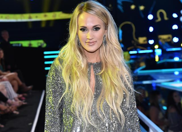 Carrie Underwood, pictured at the 2018 CMT Music Awards on June 6, 2018, reflects on her facial injury — and the online rumors about it. (Photo: Jeff Kravitz/FilmMagic)
