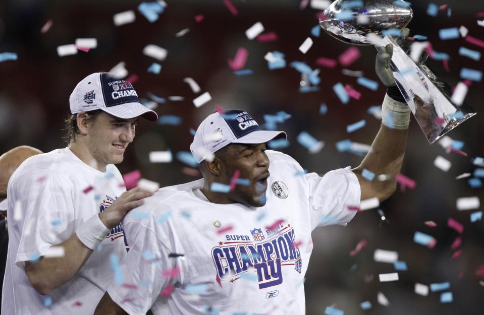 New York Giants quarterback Eli Manning, left, and Michael Strahan celebrate their 17-14 win over the New England Patriots in Super Bowl XLII at University of Phoenix Stadium on Sunday, Feb. 3, 2008, in Glendale, Ariz.