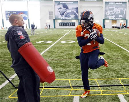 Denver Broncos running back Knowshon Moreno runs a drill as an assistant stands by during their practice session for the Super Bowl at the New York Jets Training Center in Florham Park, New Jersey