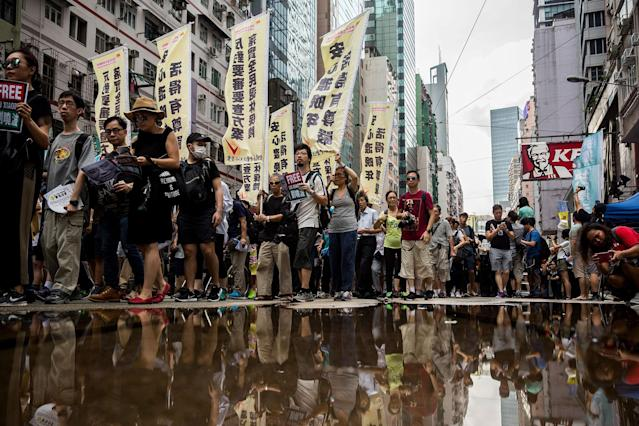 <p>People attend a protest march in Hong Kong on July 1, 2017, coinciding with the 20th anniversary of the city's handover from British to Chinese rule. (Photo: Isaac Lawrence/AFP/Getty Images) </p>