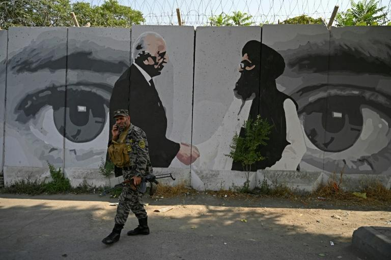The ArtLords mural showing a handshake between a US envoy and a Taliban leader is among the pieces painted over in recent days (AFP/WAKIL KOHSAR)