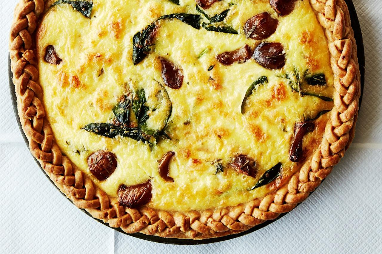"""The unsung hero of this dish? The nutty-sweet garlic. But just look at that pretty crust. We promise the braiding isn't hard, and it's sure to impress your brunch guests. <a href=""""https://www.epicurious.com/recipes/food/views/caramelized-garlic-spinach-and-cheddar-tart-51263670?mbid=synd_yahoo_rss"""">See recipe.</a>"""