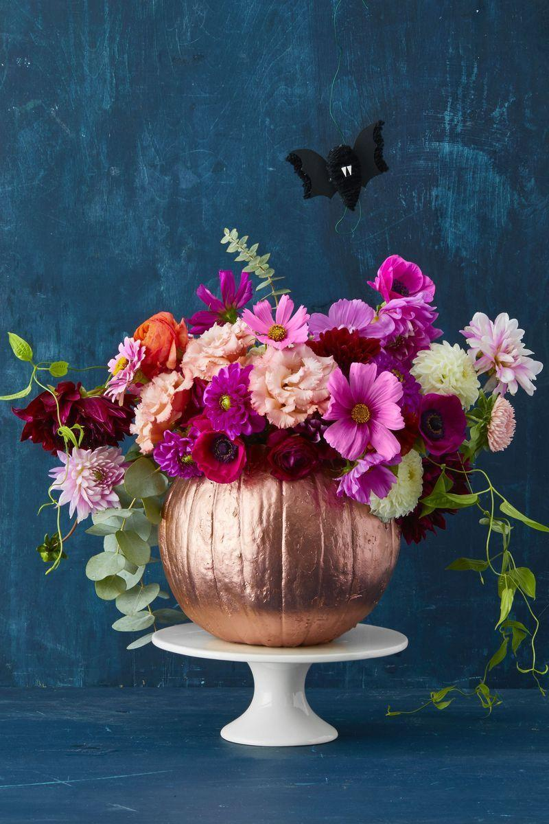 """<p>After covering your pumpkin with metallic spray paint, carve a deep hole in the top, then slide in a plastic cup. Fill the cup with water and a medley of bright blooms.</p><p><a class=""""link rapid-noclick-resp"""" href=""""https://www.amazon.com/Huapa-Halloween-Pumpkin-Carving-Professional/dp/B07H87WFMN/?tag=syn-yahoo-20&ascsubtag=%5Bartid%7C10055.g.238%5Bsrc%7Cyahoo-us"""" rel=""""nofollow noopener"""" target=""""_blank"""" data-ylk=""""slk:SHOP PUMPKIN CARVING KITS"""">SHOP PUMPKIN CARVING KITS</a></p><p><strong>RELATED:</strong> <a href=""""https://www.goodhousekeeping.com/holidays/halloween-ideas/g421/halloween-decorating-ideas/"""" rel=""""nofollow noopener"""" target=""""_blank"""" data-ylk=""""slk:Simple Halloween Decoration Ideas"""" class=""""link rapid-noclick-resp"""">Simple Halloween Decoration Ideas </a></p>"""